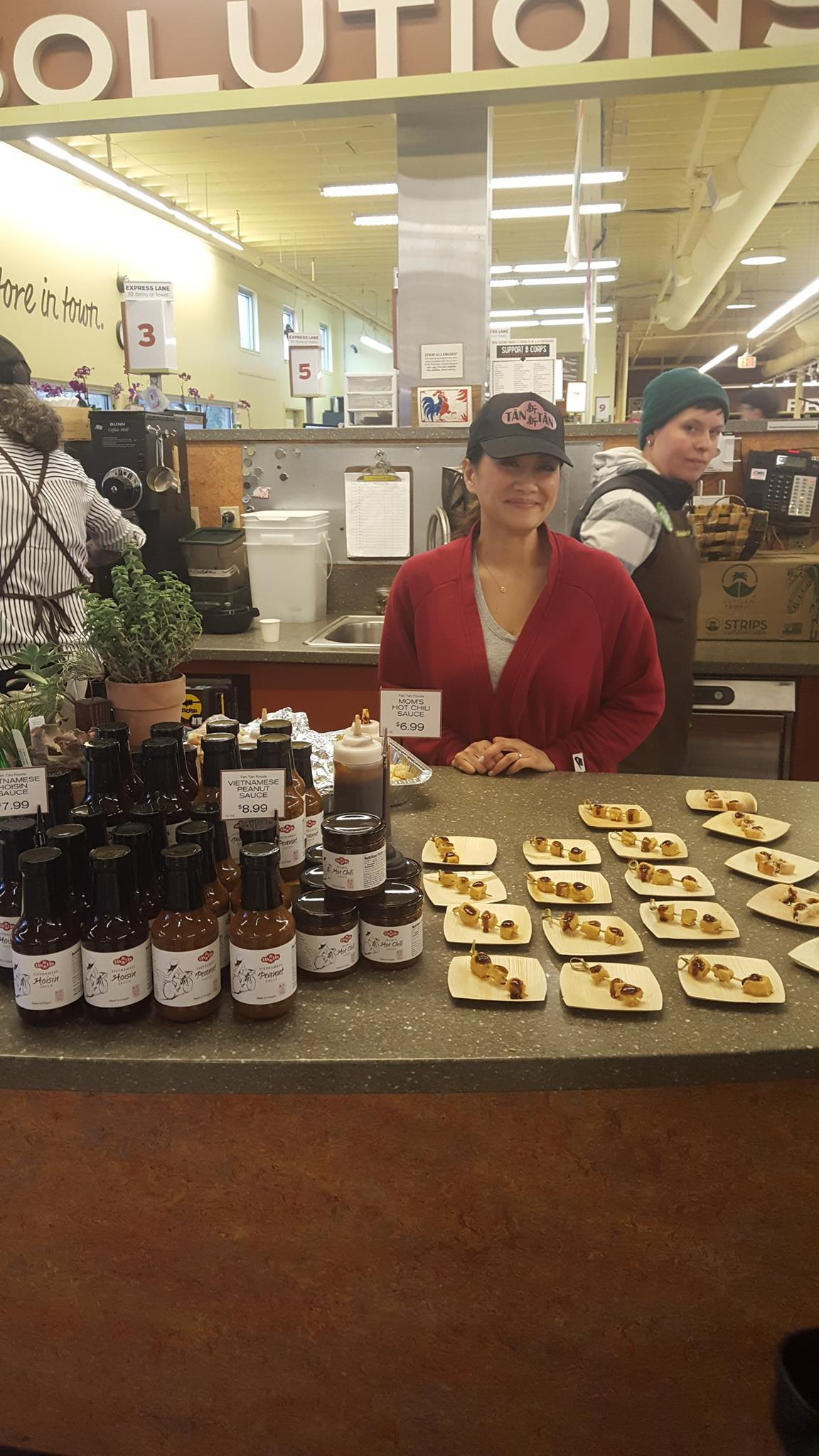 Lisa Tran at New Seasons demoing her sauces created in Getting Your Recipe to Market.jpg